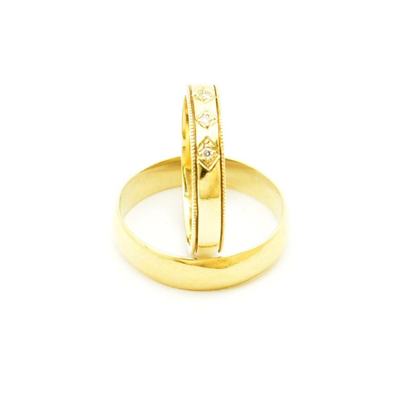 Obrączki ślubne z brylantami zrobione ze złota 585