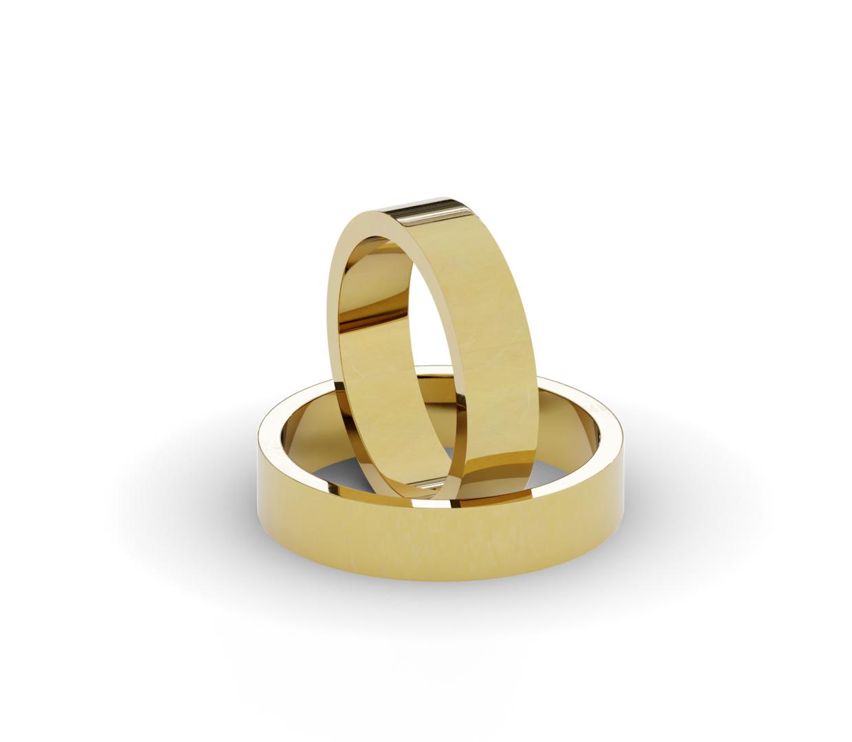 Klasyczne obrączki ślubne z żółtego złota.