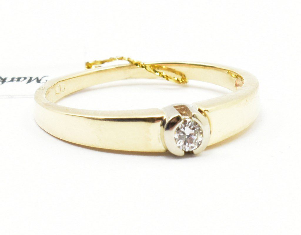 Pierścionek zaręczynowy z brylantem 0,07 ct Vs2/G