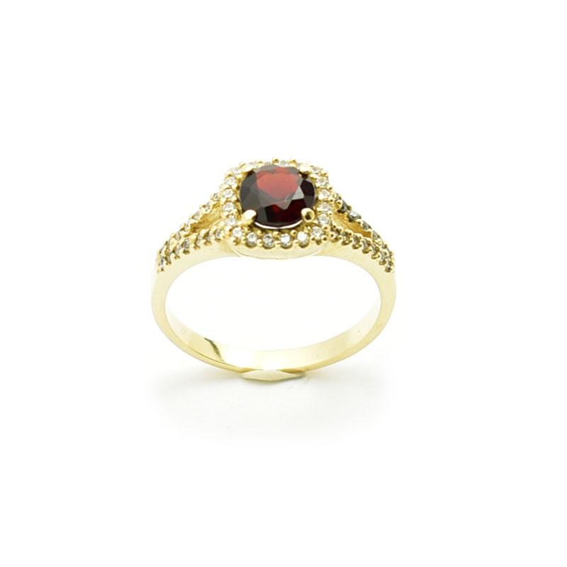 Złoty pierścionek z granatem i cyrkoniami.