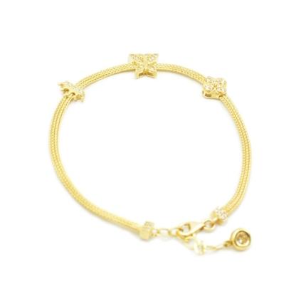 Złota bransoletka taśma z cyrkoniami.