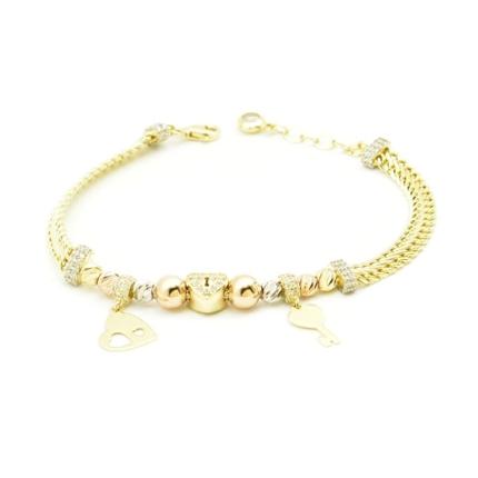 Złota bransoletka z przekładkami, zawieszkami i cyrkoniami