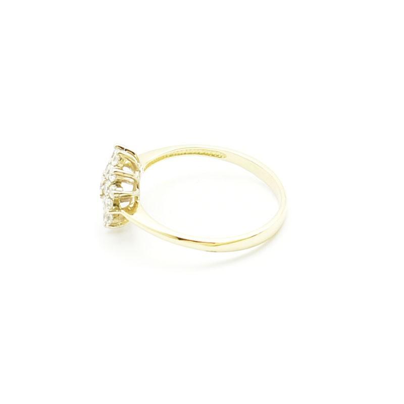 Złoty pierścionek z cyrkoniami z odlewni iza.