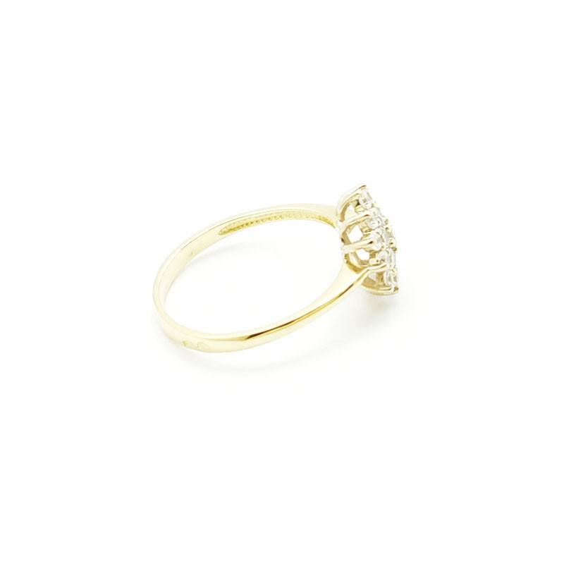 Złoty pierścionek z cyrkoniami.