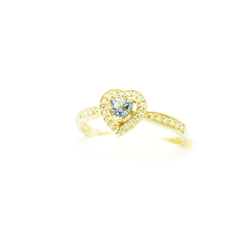 Złoty pierścionek z topazem i cyrkoniami.